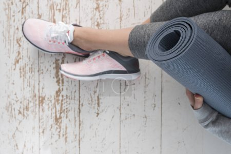 Young woman with grey mat
