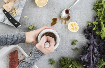 Photo for Woman preparing Soy Salmon with Kale - Royalty Free Image