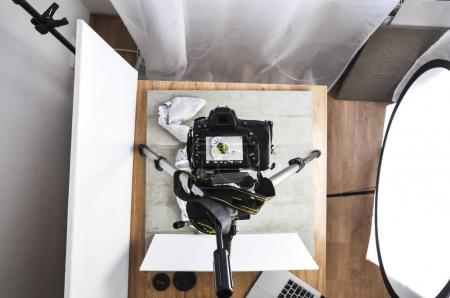 Photo for Modern photo camera on tripod taking pictures of food, food blog concept - Royalty Free Image