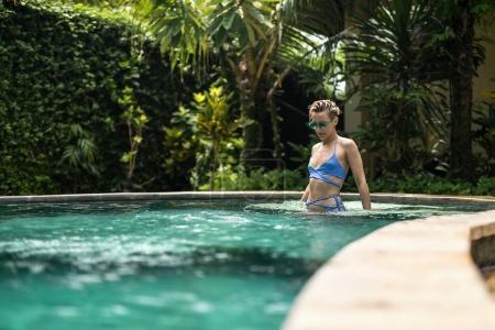 Blonde girl in pool