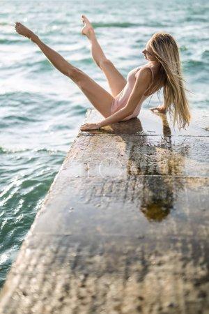 Ballerina posing on seafront