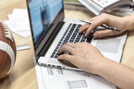 Guy using laptop in office