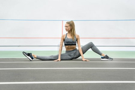 Sportive girl training outdoors