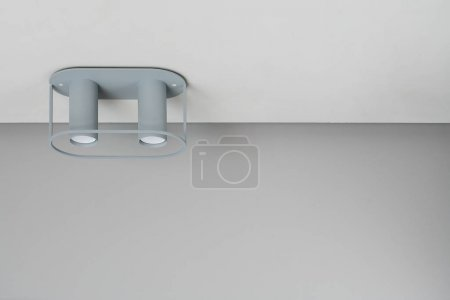 Gray double lamp on ceiling