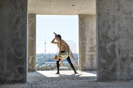 Ballet dancers posing at unfinished building