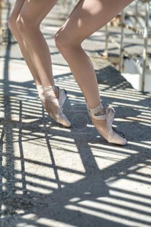 Legs of ballet dancers outdoors