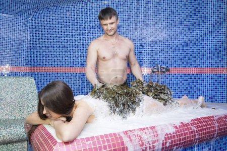 woman on the procedure of the foam massage