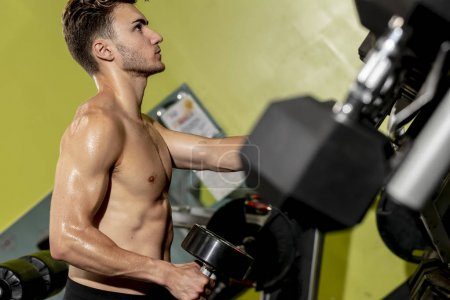 Male Athlete Working Out At A Local Gym