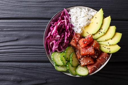Raw Organic Ahi Tuna Poke Bowl with Rice and Veggies close-up. H