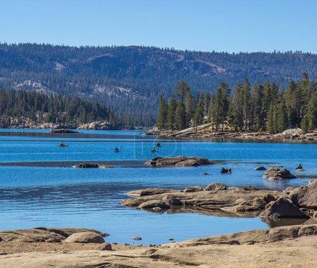 Kayaks Near Shore On Mountain Lake