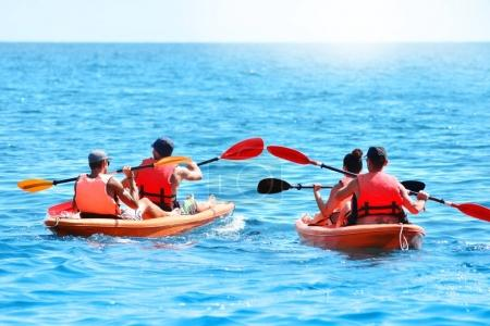Group of kayaks are swimming by the sea