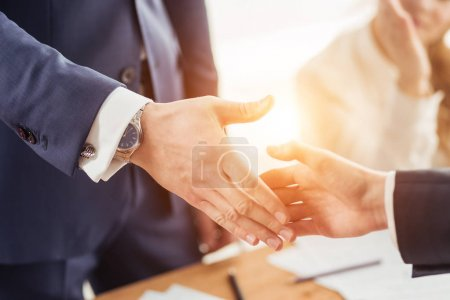 Photo for Business handshake at office. blured people at background - Royalty Free Image