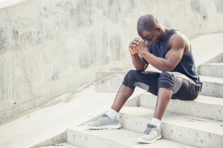 Young Sport man resting after workout exercise.