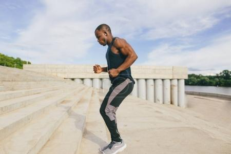 Sportive man training outdoors - Runner jogging, healthy lifestyle concept.