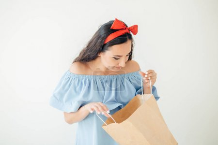 portrait beautiful happy surprised woman girl holding in her hands shopping bag