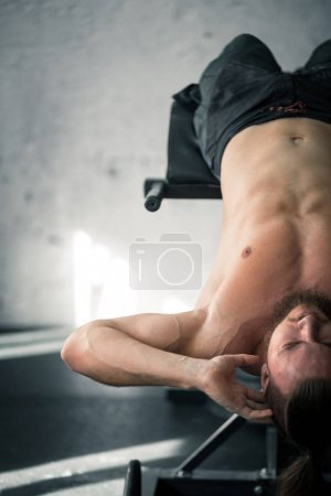fit lean young man exercising in a gym