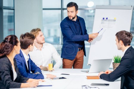 Director of company having business meeting with his staff