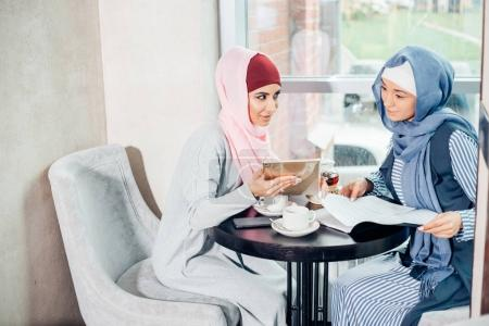 portrait of young arabic woman working with tablet