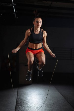 woman Exercises with Jump or Skipping Rope in Gym