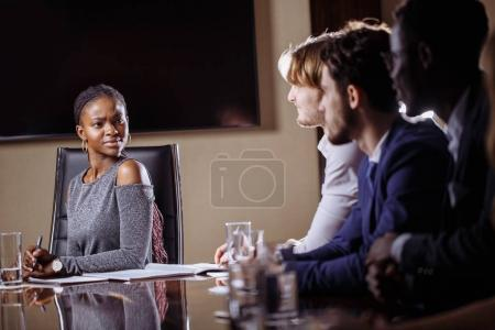 Female team leader on Meeting Discussion Talking in office conference room