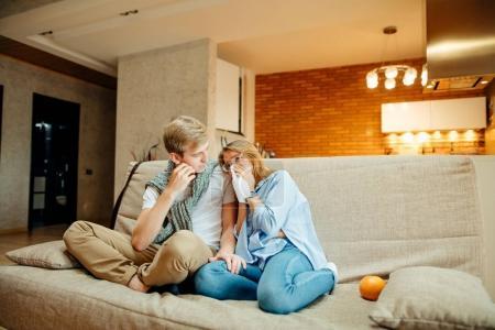 couple watching sad movie, woman cry