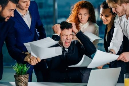 stressed Businessman in office scream, upset with employees ask for attention
