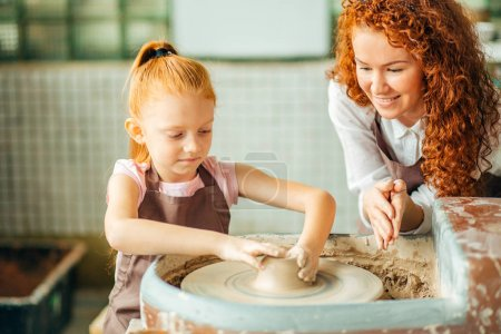redhead sisters make a pitcher of a pottery wheel