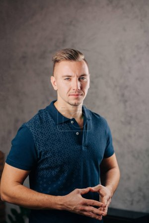 man leaning against a concrete wall and thinking