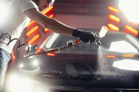 Car wash and coating business with ceramic coating.Spraying varnish to car.