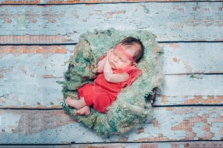 sweet newborn baby sleeping in children nest