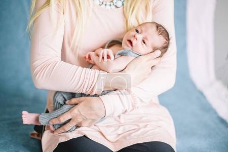 newborn on hands at mum
