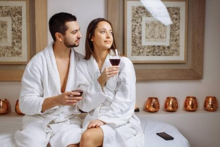 couple in a luxury spa tasting a glass of white wine