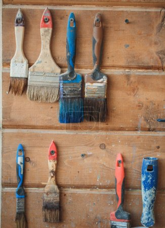 Old Brushes photographed on wooden background