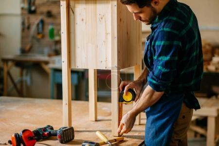carpenter working in his woodwork or workshop