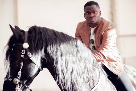 man riding brown horse on countryside