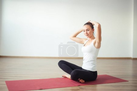 Women preparing for doing yoga. do hairstyle