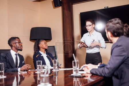 businesswomen interacting at the meeting in modern office