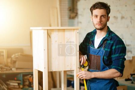 carpenter working in his woodwork or workshop