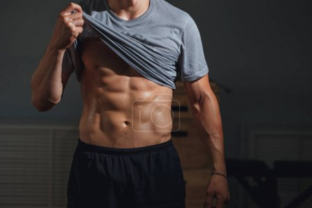 Man with muscular torso showing six pack abs