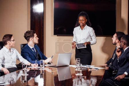 Businesswoman Leads Meeting Around Table Shot