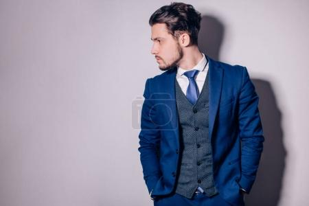 Photo for Portrait of happy businessman with arms crossed standing in office - Royalty Free Image