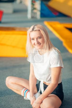 girl resting after jumping on trampoline