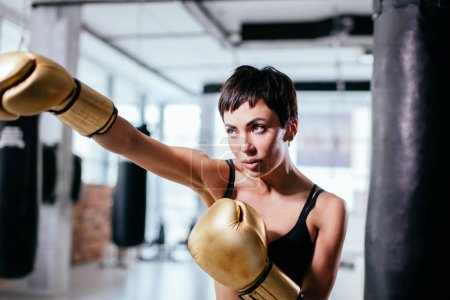 side view shot of brave woman standing in boxing pose