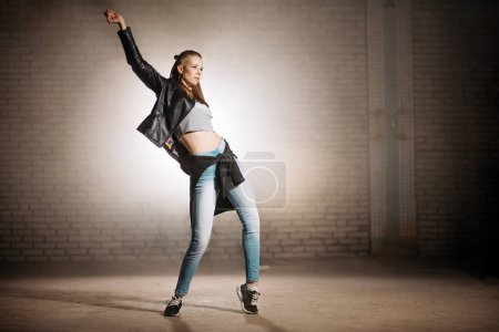 young street woman doing movements with hips. hip action