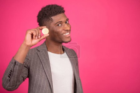 African magician is doing magic tricks with coin.