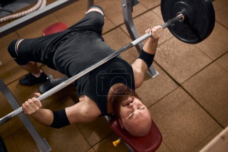 Weightlifting fitness man bodybuilding or powerlifting at gym