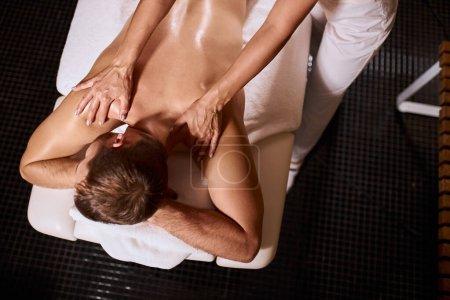 Man has deep tissue massage on the back
