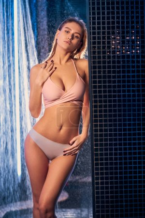 Photo pour Attractive young female in underwear take shower alone, caucasian woman have perfect figure, body. freshess and body care concept - image libre de droit