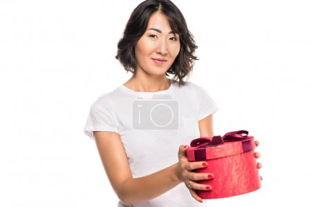 Photo for Beautiful asian woman with red gift box, isolated on white - Royalty Free Image