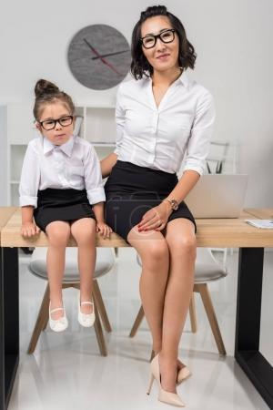 asian businesswoman with daughter